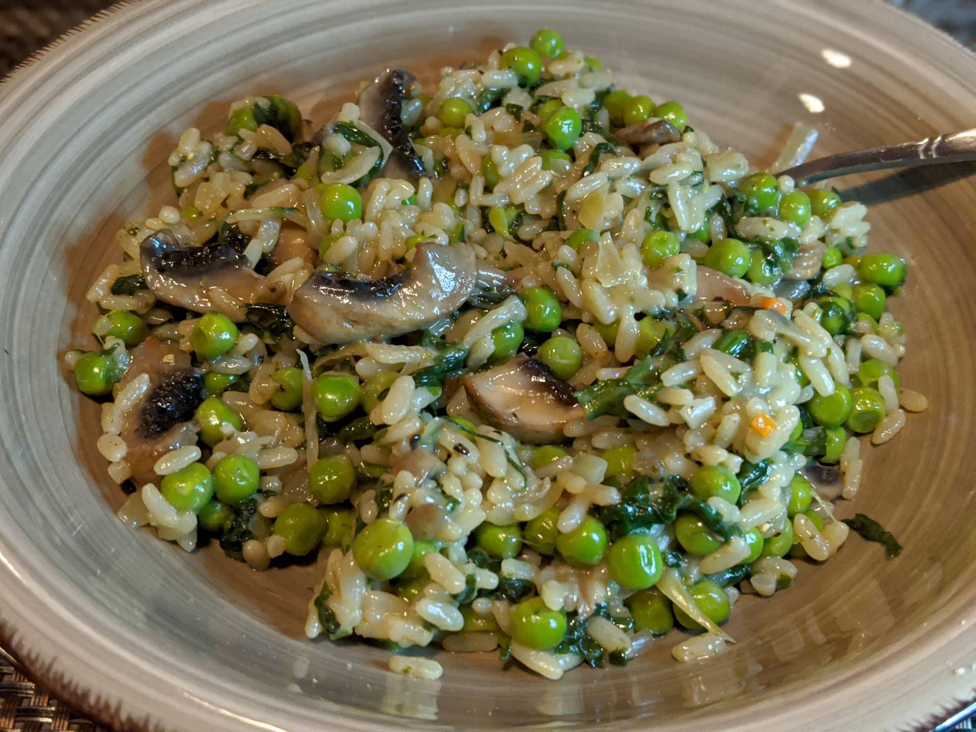 Recette de risotto aux épinards, petits pois et champignons